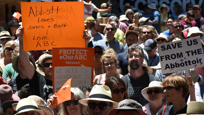 Thousands gather for a Save the ABC rally at Town Hall in Sydney, Saturday, Nov. 22, 2014. The Abbott Government has broken an election promise to not cut funding to the ABC and SBS. (AAP Image/Dean Lewins)