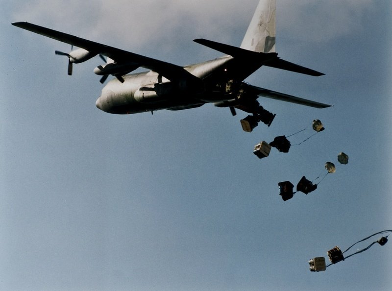 A RAAF C130 dropping bananas to those recovering from the Colombian Flu in Dover Heights.