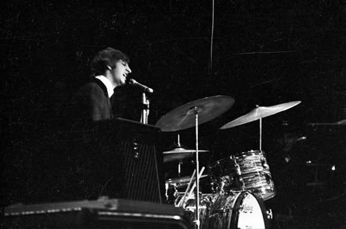 A young Ringo Starr on stage with The Beatles, singing the one song that they ever allowed him to sing solo - Yellow Submarine