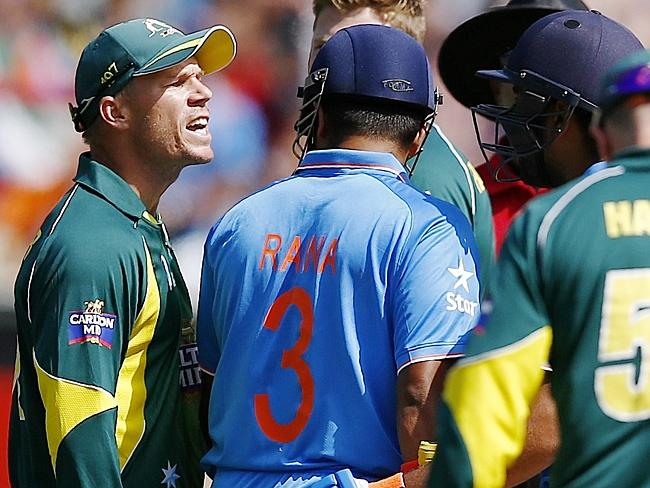 "David Warner delivering his ""verbal rinsing"" to Indian batsman, Rohit Sharma"