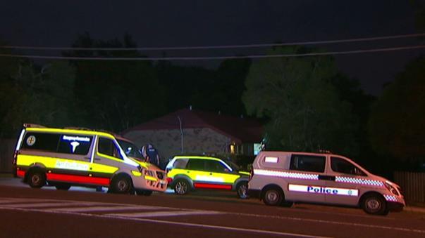 Police investigating the scene outside of Mr Flynn's Taree residence