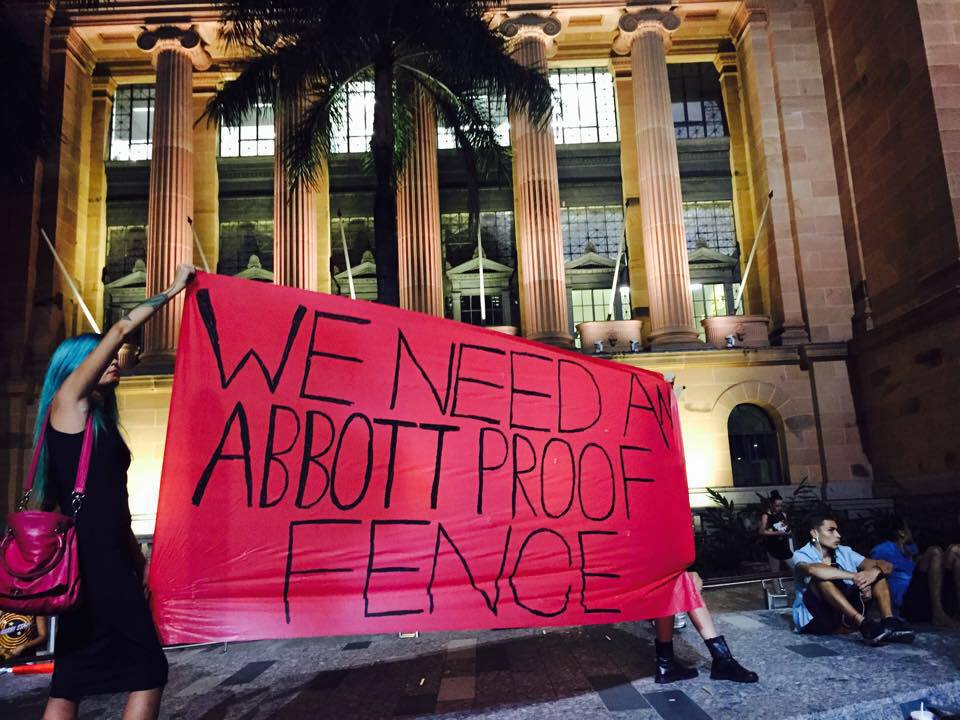 Activists take to the streets of Brisbane protesting the imminent closure of Indigenous communities last night. Credit: Gracie Eather