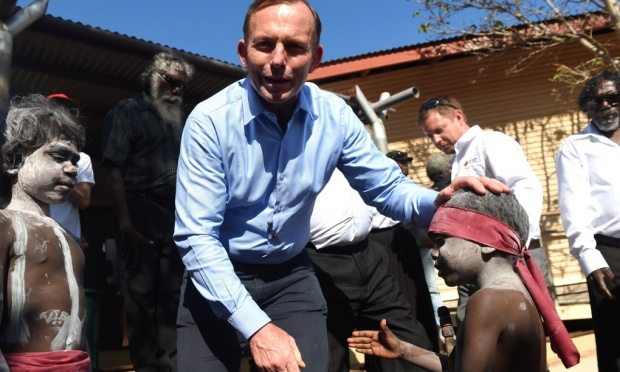 Tony Abbott patronises an Aboriginal boy by patting him on the head despite being offered a handshake