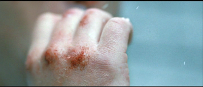Mr Flynn's hands, photographed as he left the Taree police station