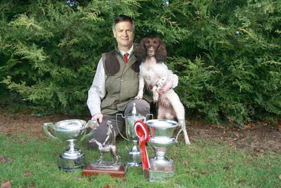"""""""It's a passion of mine"""" Bolt pictured with his award-winning spaniel bitch, Peta. SOURCE: Fairfax Media."""