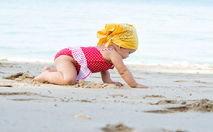 Magnolia's youngest, Aquila , plays in the sand without fear of getting autism from state-sanctioned injections