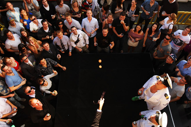 Punters try their luck in a game of two-up following the Anzac Day Dawn service and march.