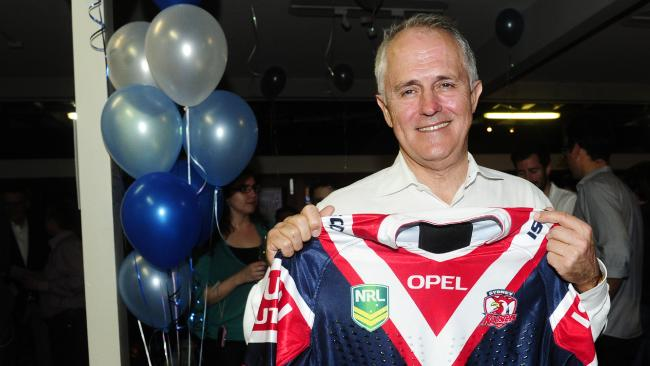 Malcolm Turnbull shows his eastern suburbs colours after the Sydney Roosters won the minor premiership in 2013, the night he was re-elected to his seat of Wentworth