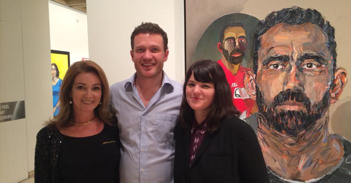 Julie Fison, Archibald 2014 finalist Alan Jones and Archibald 2014 winner Fiona Lowry with Jones' portrait of Adam Goodes - an Australian footballer who is more popular than the entire Australian art scene.