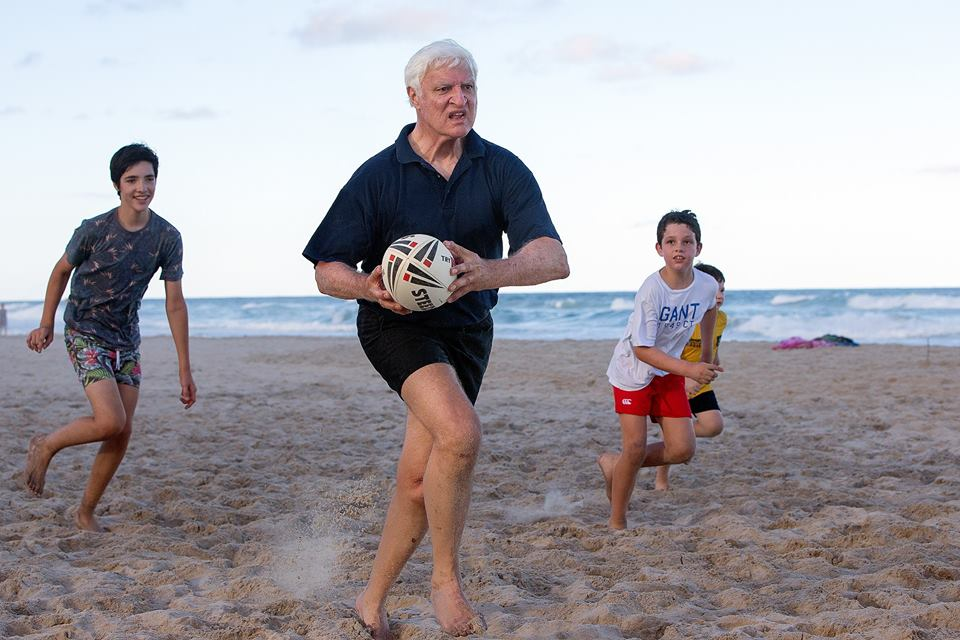 Federal Politician Bob Katter absolutely dominating his grandsons in a beach rugby league match